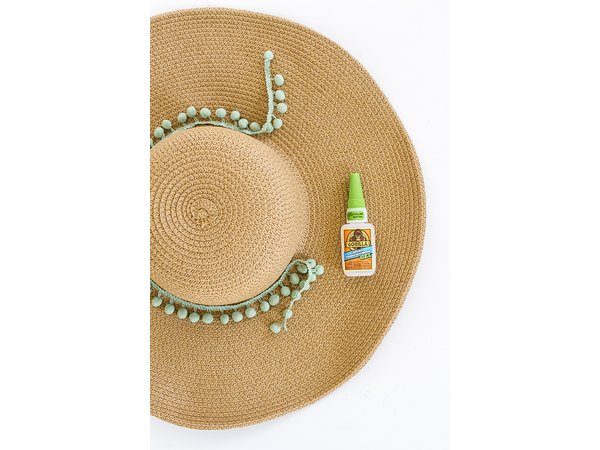 Squeeze a line of glue onto the hat where it meets the rim.
