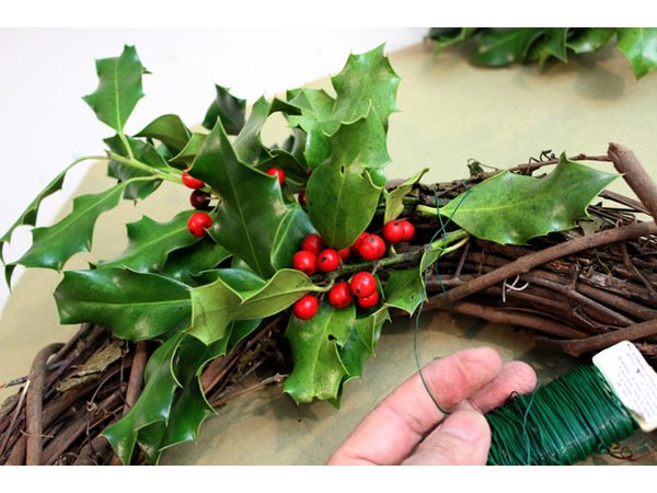Wrap wire around the first bunch of holly.