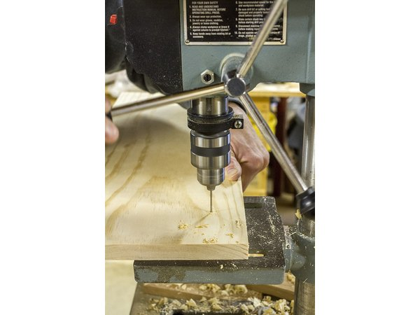 Use a drill or drill press to drill the holes for the feet brackets.