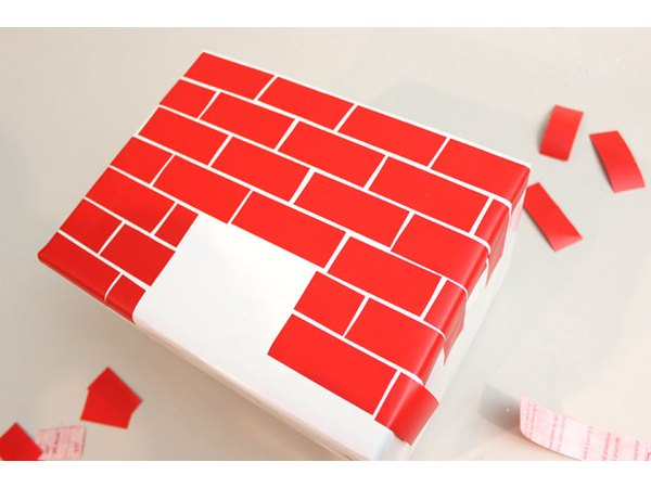 "Apply the ""brick"" strips to the box."