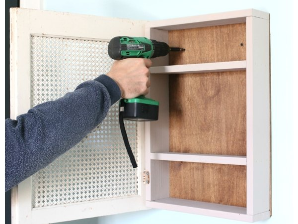 Place a level on top of the cabinet to ensure an even installation.