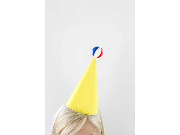 Wear the beach ball-topped hat with pride.