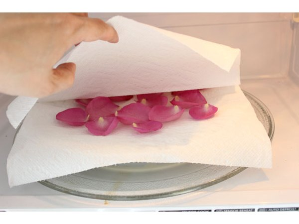 Dry rose petals between paper towels in the microwave oven