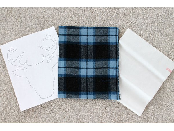 Cut the flannel and adhesive paper to size.
