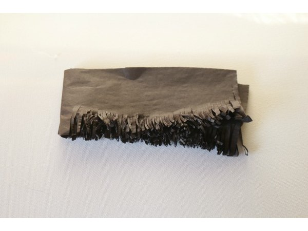 Black tissue paper, folded and cut