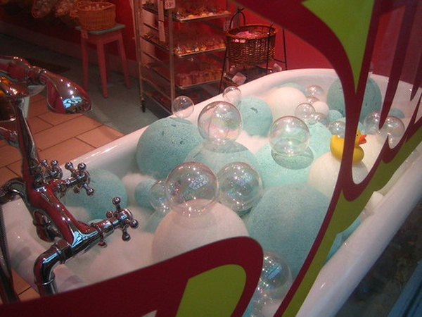 Tub full of bubbles and spheres.