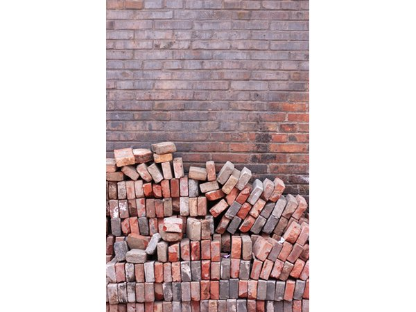 Recycle used bricks to provide drainage for your container garden