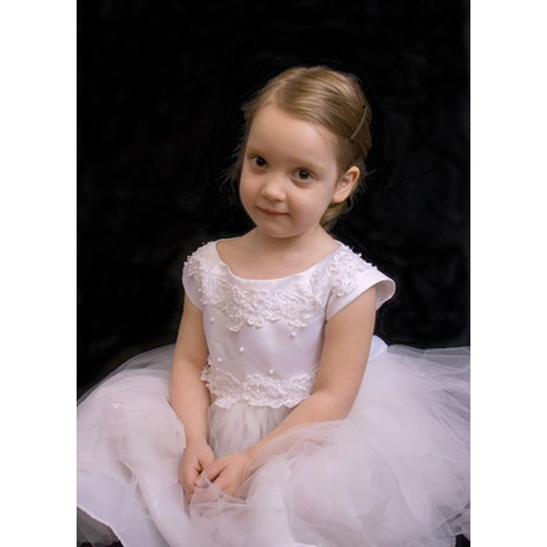 Flower girl dresses are made puffy by underskirts.