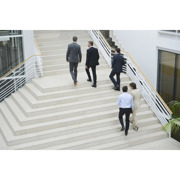 Business colleagues using staircase