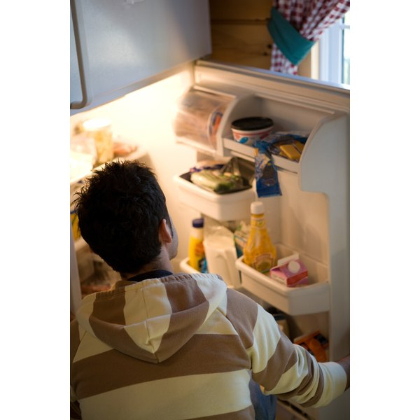 Man looking inside refrigerator