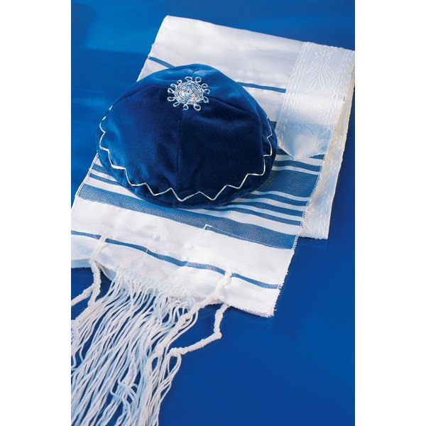 Jews examine the tzitzit for wear before donning the tallit.