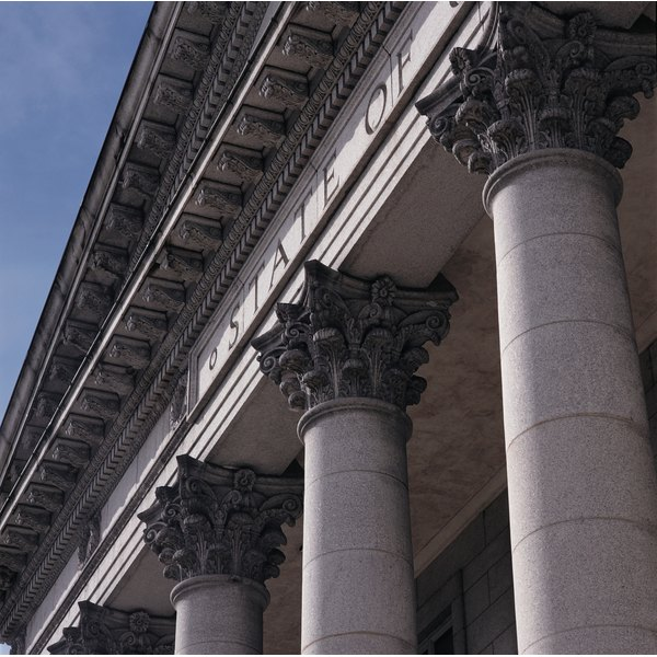 corinthian capitals head columns that rise to a blue sky