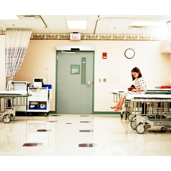 Girl patient sitting in hospital room