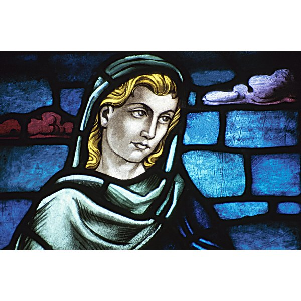 Stained-glass window of a sad woman