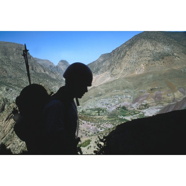 Silhouette of soldier hiking in mountains