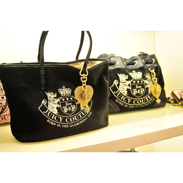 The Juicy Couture logo is usually splashed on the outside of the bag.