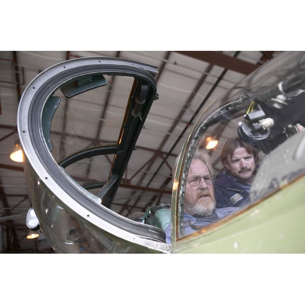 Engineers working in cockpit