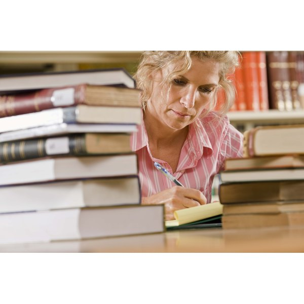 Woman with books in library