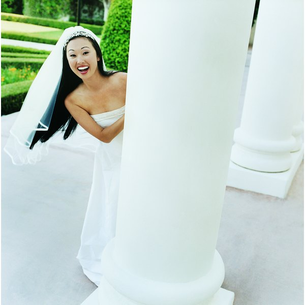 Decorate wedding columns for a customized look.