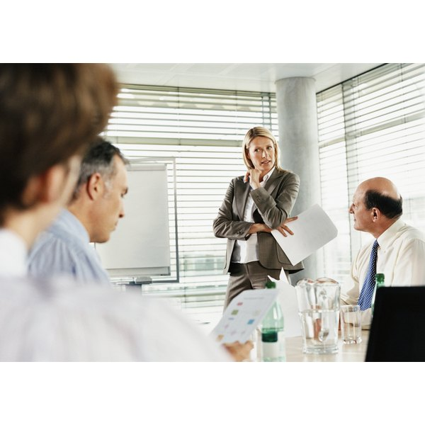 Businesswoman Standing and Listening in a Boardroom Meeting
