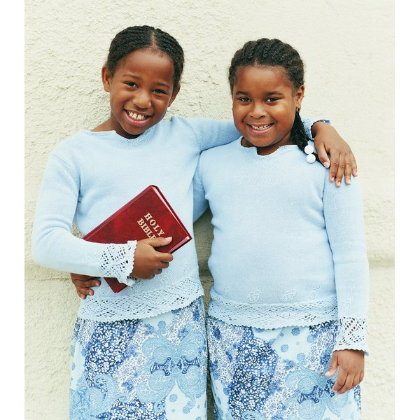 Portrait of a Young Girl Holding a Bible With Her Arm Around Another Smiling, Young Girl
