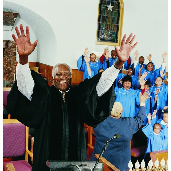 Priest Standing on a Pulpit With His Arms Upraised in Front of a Gospel Singing Choir