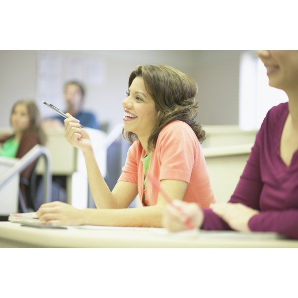 Side profile of a young woman smiling in a classroom