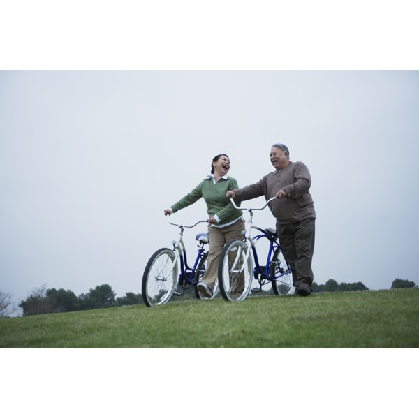 Smiling couple with bicycles