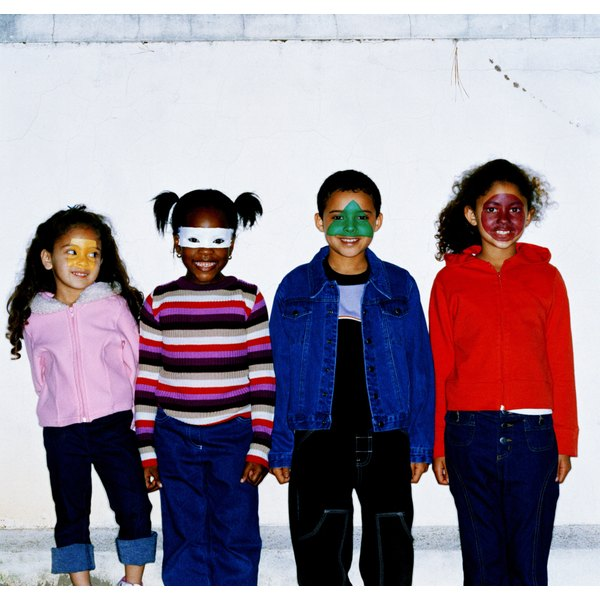 Portrait of a group of children (6-10) standing with faces painted