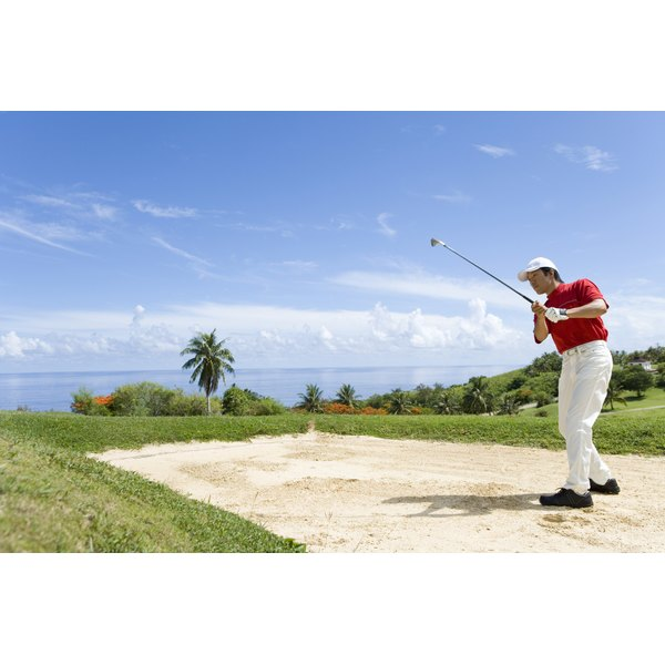 Man playing shot from bunker, Saipan, USA