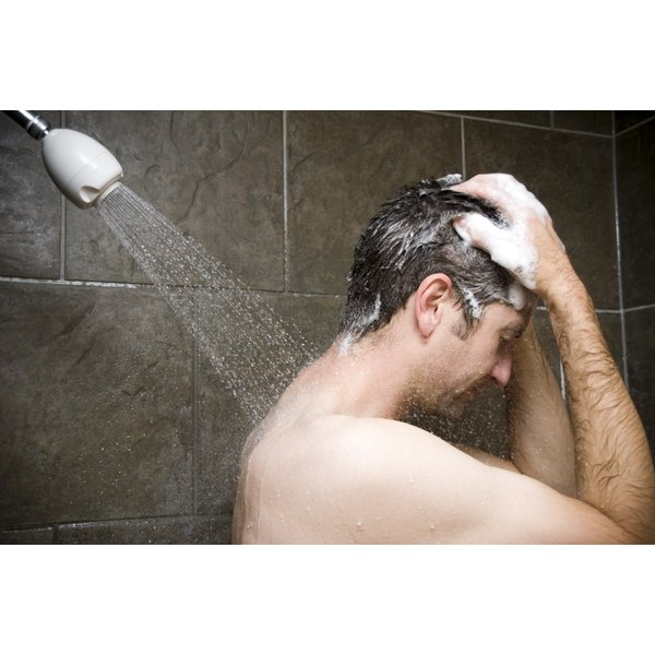 Man Showering, Water Washing Over Him