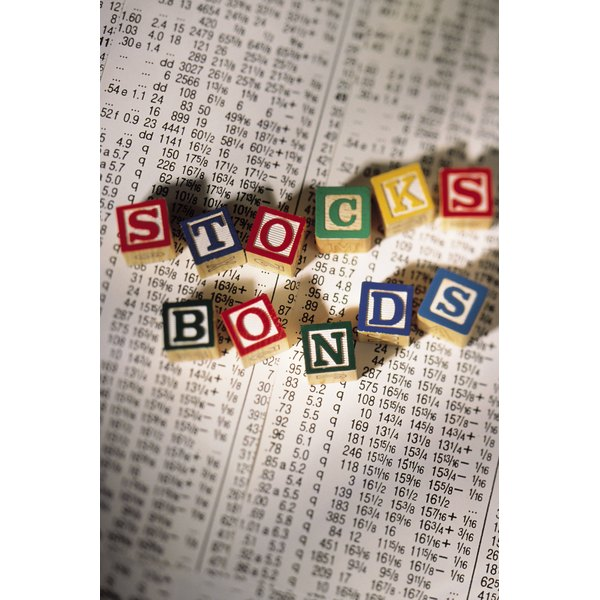 Alphabet blocks on top of newspaper spell stocks and bonds