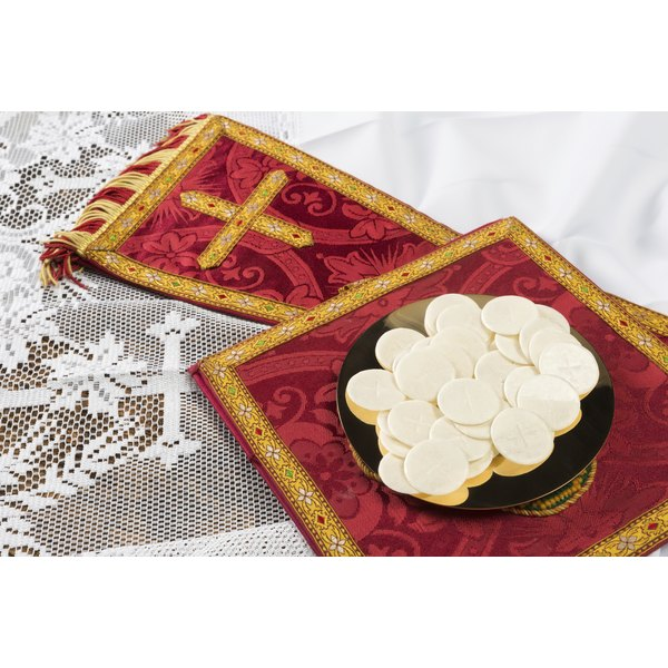 Communion hosts or wafers and vestment