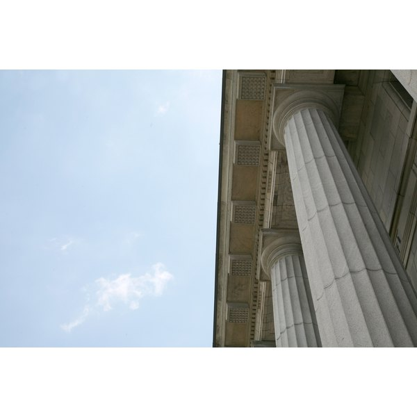Low angle view of doric columns on exterior of building