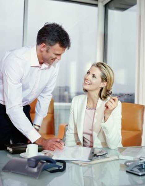 Signs a Man Is Attracted to You at the Workplace