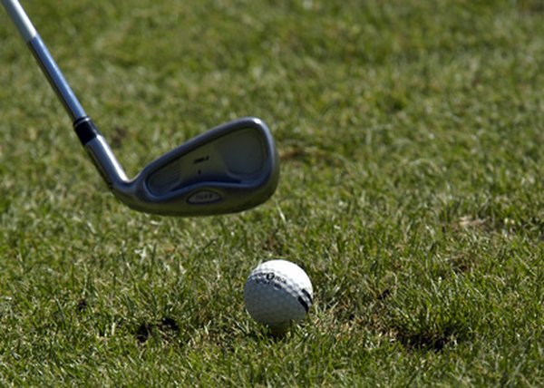 "Amateur golfers sometimes try to ""scoop"" the ball when hitting long-iron shots."