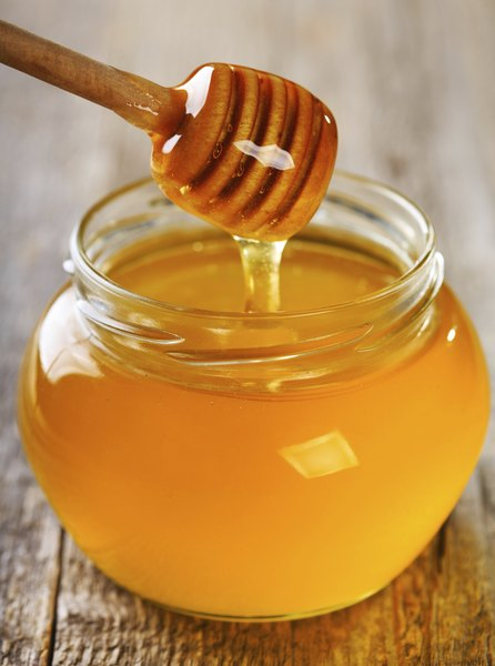 A bit of honey is a natural remedy to help your dog's cough.