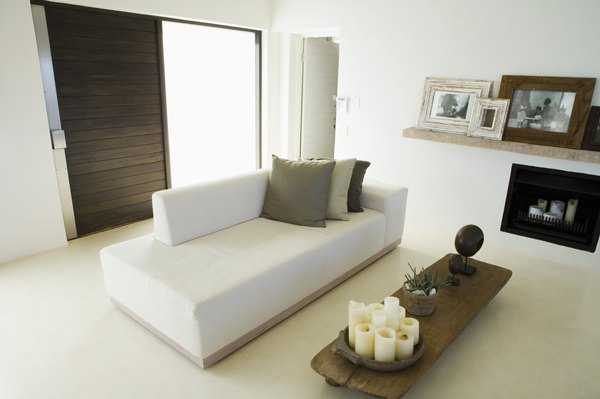 Wood Tone Furniture Coordinates With A White Couch.