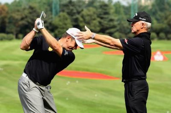 See how the shoulders turn first to start the backswing.