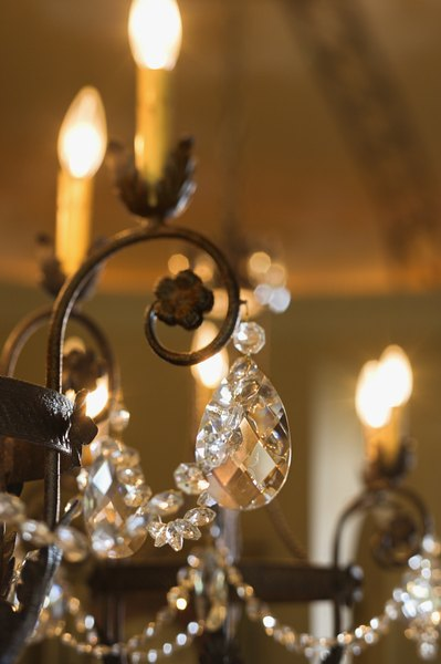 Brass and dual sided facets on drops are clues to the chandeliers age