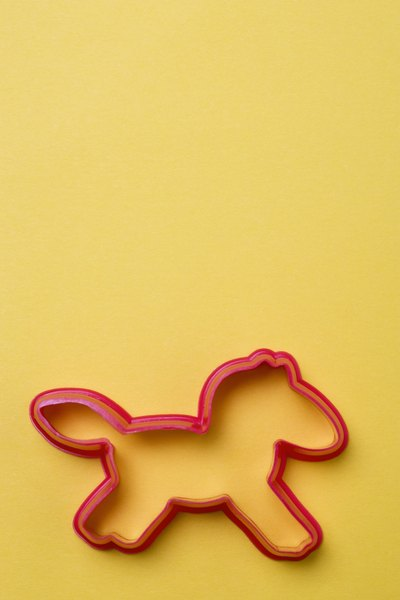 Use a cookie cutter, drinking glass or biscuit cutter for easy dog treat shapes.