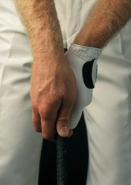 In a strong golf grip, the right thumb is pointed slightly right-of-center.