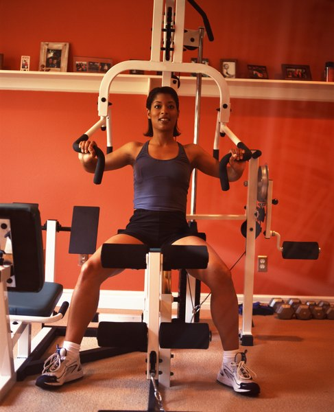 Exercises for stacked weight home gyms woman