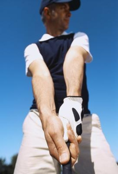 A golf glove is used to stabilize your grip on the club, according to GolfMagic.com.