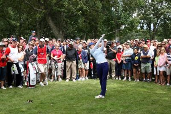 Michelle Wie hits a 3-wood during the 2009 Solheim Cup.