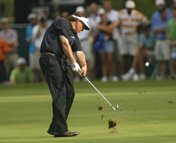 Pros leave divots when they hit down and through the ball correctly.
