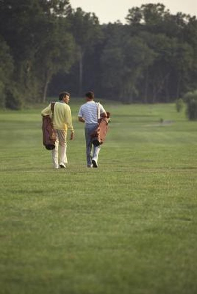 Walking a golf course while carrying your bags can help burn calories.