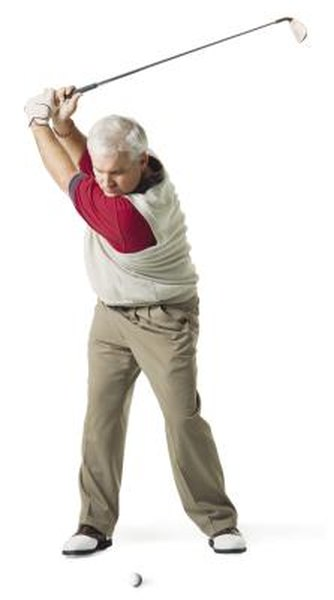 The left arm should be straight at the top of the backswing.