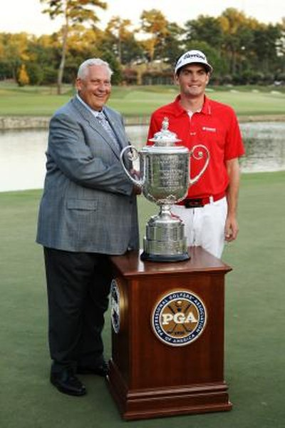 PGA of America President Allen Wronowski, left, and Keegan Bradley pose with the Wanamaker Trophy after Bradley's victory in the 2011 PGA Championship.