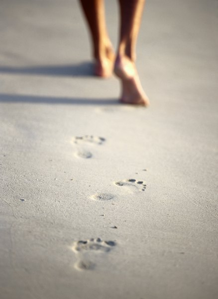 Walking barefoot in areas with infected dog feces increases the risk of hookworms.